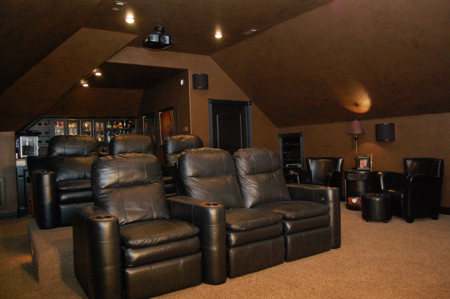 Comfy Home Theater Featuring Granite Bar